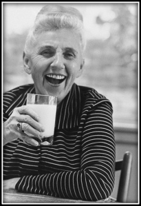 ca. 1971 --- Adelle Davis, nutritionist/author, holding a glass of milk --- Image by © Condé Nast Archive/CORBIS