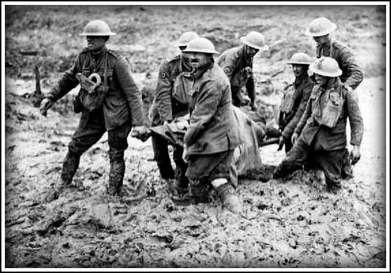 Stretcher bearers struggle in mud up to their knees